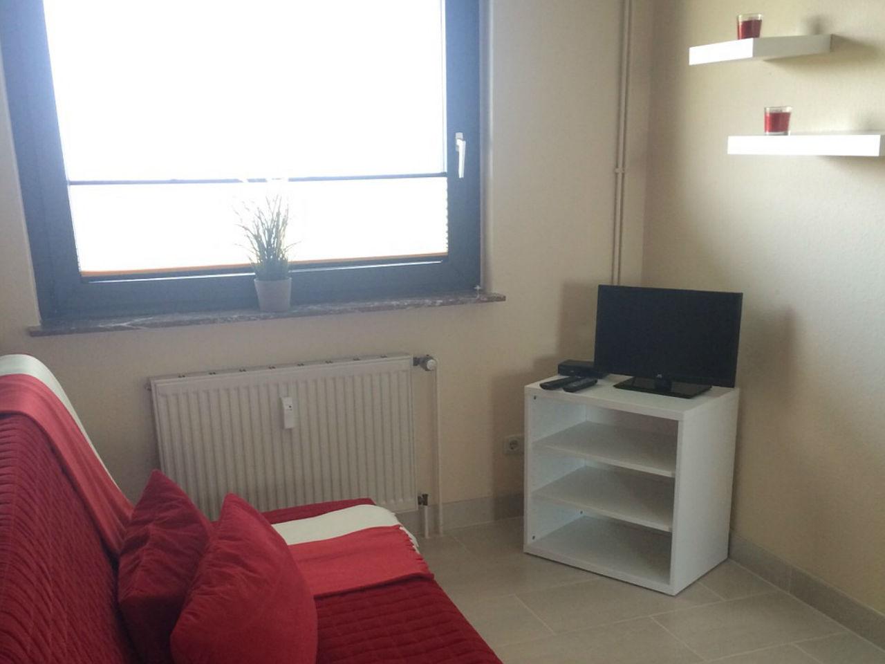 Moderne Wohnzimmer eingerichtet bei 1A Ferienwohnungen Sturm.
